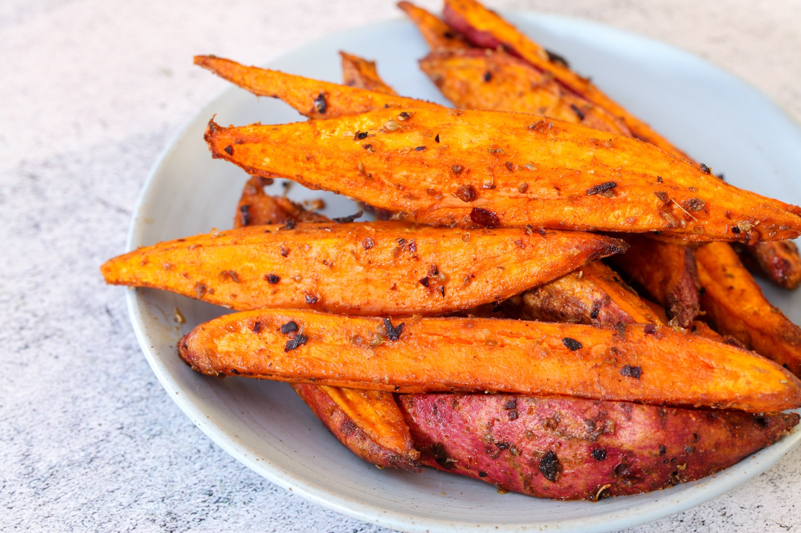 Honey glazed sweet potato wedges w chili, lemon & oregano